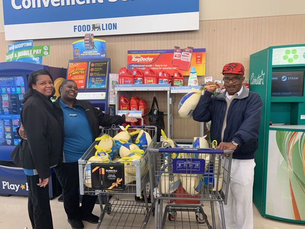 Two carts displaying Thanksgiving turkeys sponsored by Mayor Allen Joines
