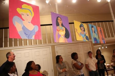 People at Event with Paintings of Disney Princesses (JPG) Opens in new window
