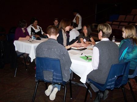 People Sitting at Tables at Community Engagement Event (JPG) Opens in new window