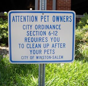 Sign Explaining a City Ordinance Requires Dog Owners to Pick up After Their Pets