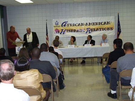 Two Men at Podium at Forum Seven at Sprague Street Recreation Center (JPG) Opens in new window